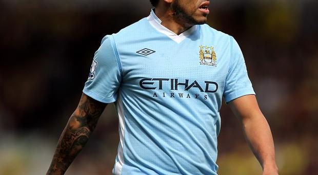 Carlos Tevez says he is happy at Manchester City