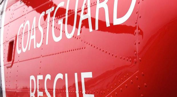 A Coastguard helicopter has helped rescue a group of Scouts who were stuck on marshland