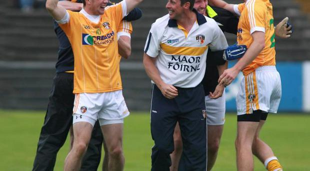 Good times: Conor Murray, Geroid Adams and Anto Healey celebrate Antrim's victory over Galway