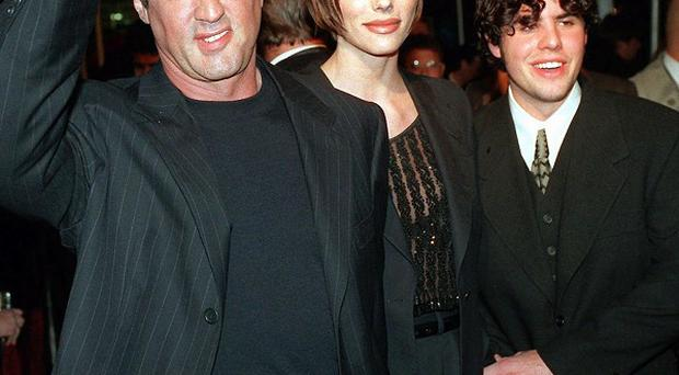 Sylvester Stallone at the premiere of Daylight in 1996 with Jennifer Flavin and his son Sage, who has died (AP)