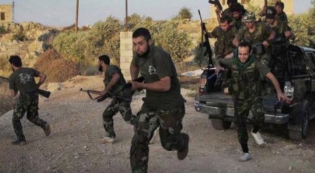 Free Syrian Army soldiers run for cover in Idlib province (AP)