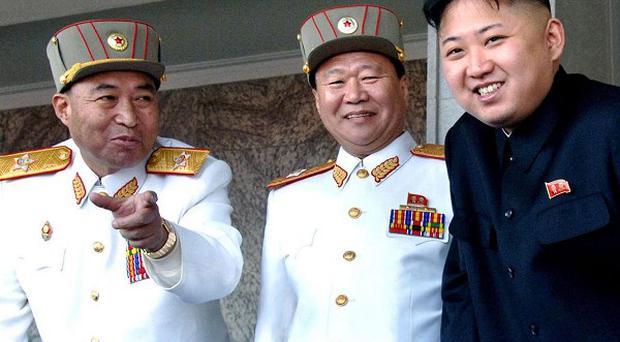 North Korean leader Kim Jong Un, right, with senior army officers, including Ri Yong Ho, left (AP)