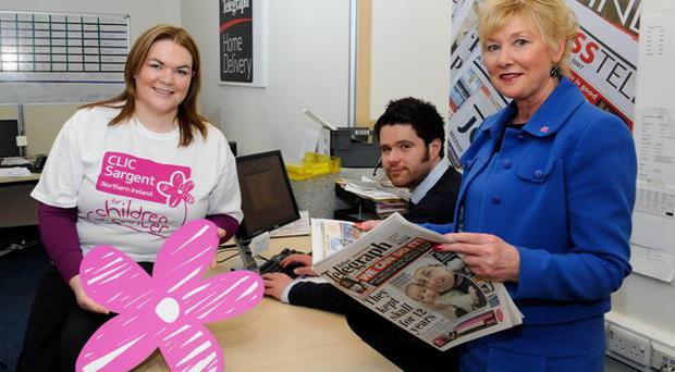 Eimear McCooey, Corporate Fundraising Manager for Clic Sargent, with Colin Young & Carol Marshall Home Delivery Customer Services for Belfast Telegraph