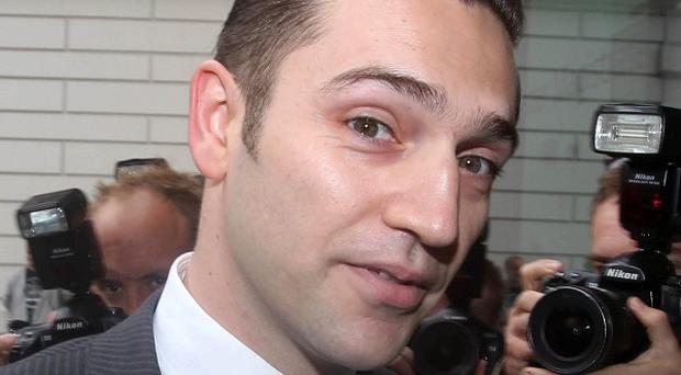 Reg Traviss arrives at Westminster Magistrates' Court where he is charged with two counts of rape