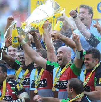 Harlequins celebrate with the Aviva trophy after victory at Twickenham