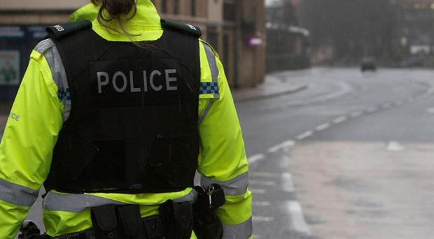 Youths attacked police carrying out a crackdown on republican vigilantes in Londonderry