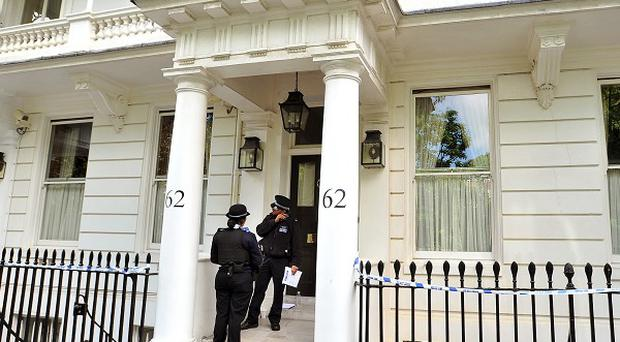 Police outside the home of Eva Rausing in Chelsea, where she was found dead