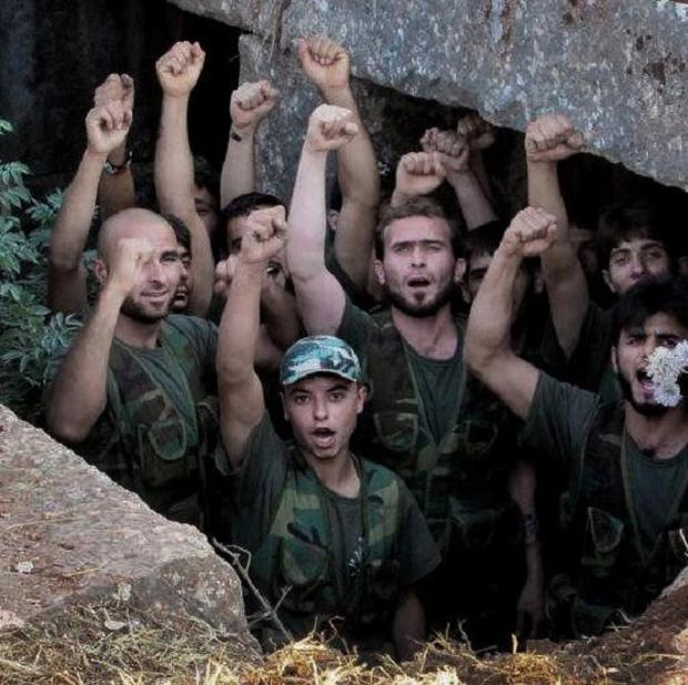 Free Syrian Army soldiers chant slogans in Idlib province, northern Syria (AP)