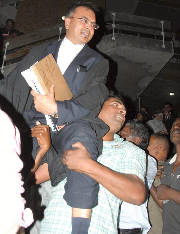 Sanjeev Teeluckdharry is held aloft by supporters of the Treebhoowoon family