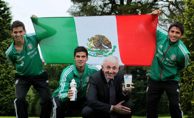 Michael Drayne, Chairman of the Dairy Council for Northern Ireland with Milk Cup Mexican team players Raol Lopez Gomez, Captain Carlos Trevino Luque and Julio Gomez Gonzalez