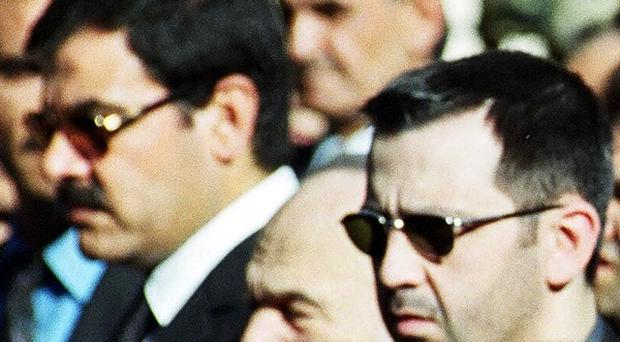 Syrian president Bashar Assad's brother-in-law, General Assef Shawkat (left), who was killed by a rebel bomb (AP)
