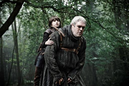 Actor Isaac Hempstead-Wright as Bran and Kristian Nairn as Hodor on the set of series three of Game of Thrones.
