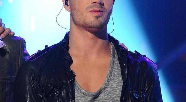 Max George blamed an over-eager fan for his 'kissing photo'
