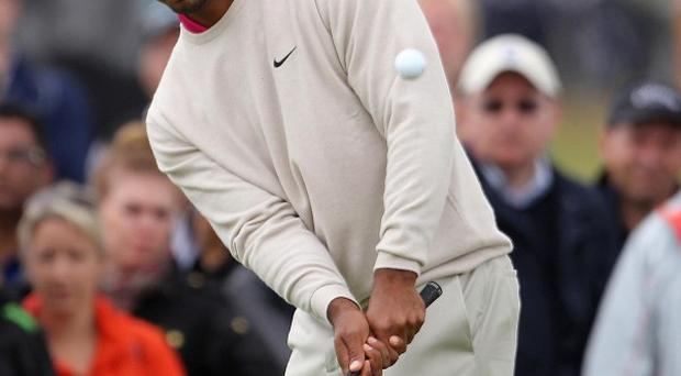 Tiger Woods leads the Open Championship on four under par