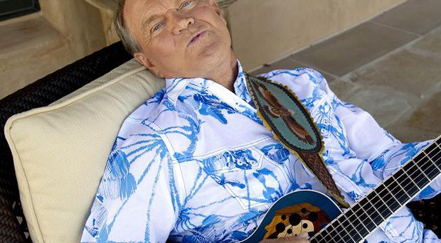 Glen Campbell is cancelling his tour of Australia and New Zealand with Kenny Rogers next month for health reasons (AP)