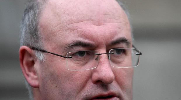 Environment Minister Phil Hogan urged firms to help solve pyrite-damage