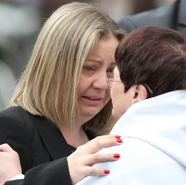 Michelle Heaton hugs the vicar of St James Church, Lynne Connolly, as she arrives for the funeral of her two-year-old son Jamie