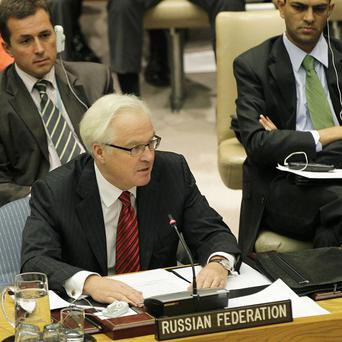 Russia's UN Ambassador Vitaly Churkin speaking before using the veto to block new sanctions against the Syrian regime (AP)