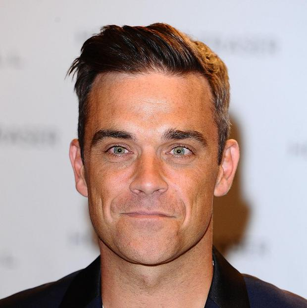 Robbie Williams surprised a fan on a social networking site