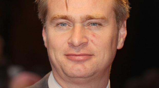 Christopher Nolan is flattered by calls for him to direct the next James Bond film