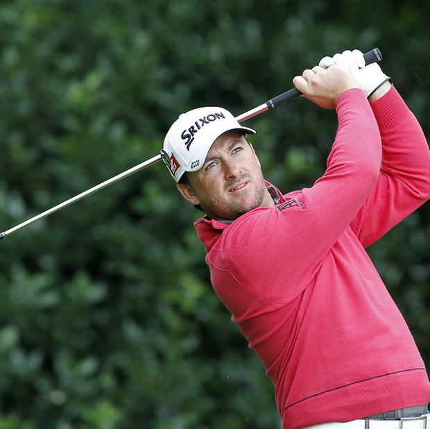 Graeme McDowell was satisfied with hisopening day's work at the Open