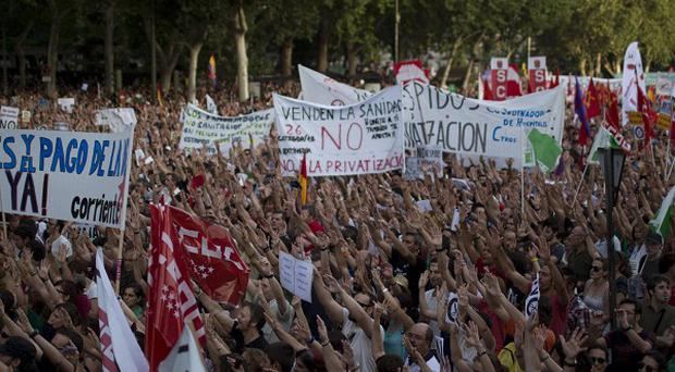 Demonstrators protest against austerity measures announced by the Spanish government in Madrid. (AP/Emilio Morenatti)