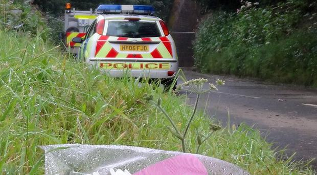 Flowers near Beaminster Tunnel, where Rosemary Snell and Michael Rolfe died after a landslide