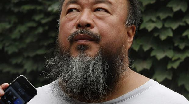 Chinese artist Ai Weiwei claims a fine over alleged tax evasion is politically motivated (AP/Ng Han Guan)