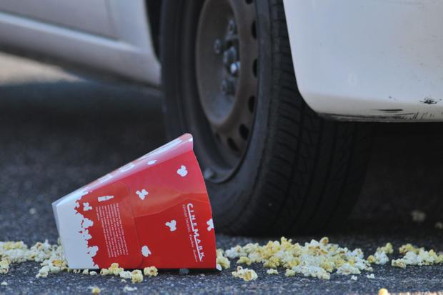 AURORA, CO - JULY 20: A Popcorn box lies on the ground outside Century 16 movie theatre where a gunmen attacked movie goers during an early morning screening of the new Batman movie,