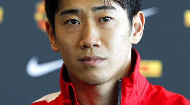 Shinji Kagawa, pictured, has been described as 'outstanding' by Sir Alex Ferguson