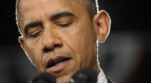 During his 2008 presidential campaign Barack Obama called for reinstating a federal ban on assault weapons (AP/Susan Walsh)