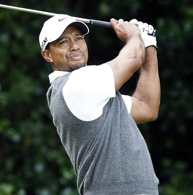 Tiger Woods dropped two shots at the start of his third round