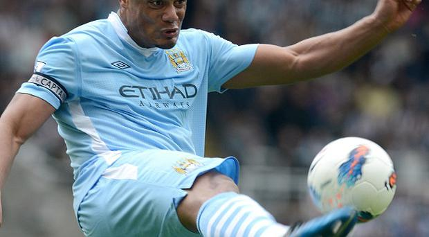 Goals from Sergio Aguero and Vincent Kompany, pictured, gave City the win