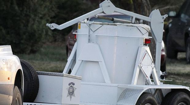 A bomb disposal vehicle arrives near the apartment of alleged gunman James Holmes (AP)