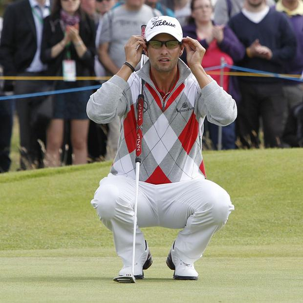 Adam Scott lines up a putt during his third round at Royal Lytham