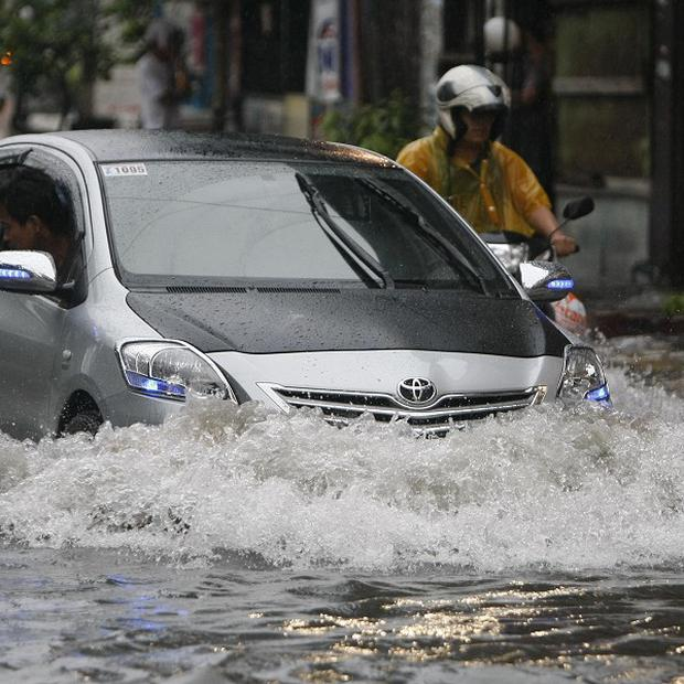 Torrential monsoon rains have inundated large areas of the northern Philippines (AP)