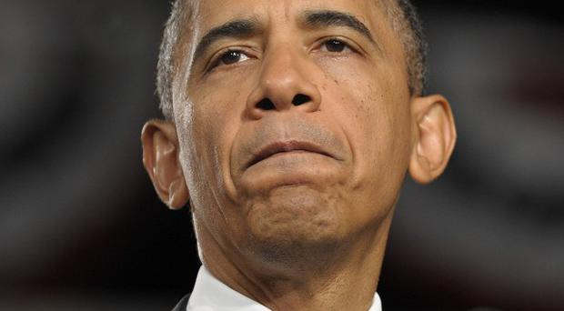 Obama said in his weekly radio and internet address that he hoped everyone took time 'for prayer and reflection' (AP/Susan Walsh)