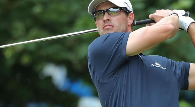Adam Scott tees off from the 1st during day four of the Open
