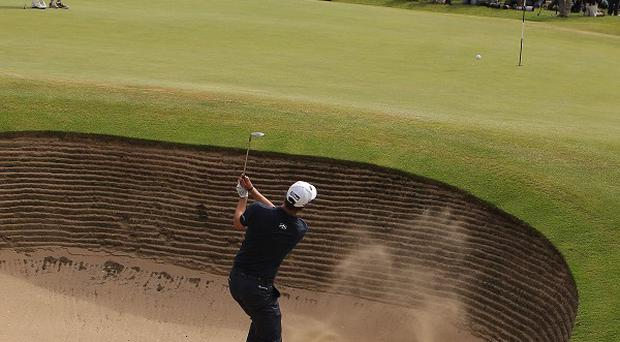 Adam Scott plays out of the bunker on the 6th during his final round