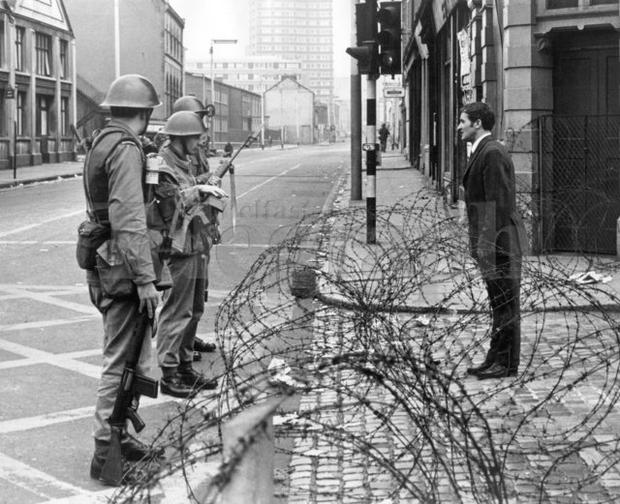 Riots : Belfast. August 1969. Barricades in Divis Street, a man talks to troops over the barricade. (16/8/69)