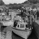 """Messing about in boats"" is as much fun for the landlubbers who just sit and watch, as it is for the proud enthusiasts tending their craft in Portna Lock, on the Bann at Kilrea. 17/8/1964"