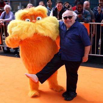 Danny DeVito and the cartoon character The Lorax at the film's UK premiere
