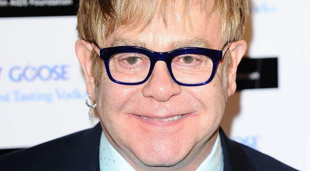Sir Elton John says his young son Zachary is showing his own musical talent