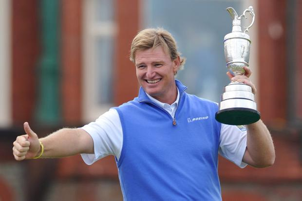 LYTHAM ST ANNES, ENGLAND - JULY 22: Ernie Els of South Africa poses with the Claret Jug after winning the 141st Open Championship at Royal Lytham & St. Annes Golf Club on July 22, 2012 in Lytham St Annes, England. (Photo by Stuart Franklin/Getty Images)