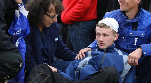 Jason Blue, aged 16, from Bristol, with a bandaged head after a stray ball from Northern Ireland's Rory McIlroy hit him on the head