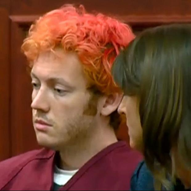 Batman killer James Holmes appears in court with dyed hair, sitting next to his lawyer (AP)