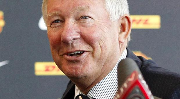 Sir Alex Ferguson, pictured, admits he has spoken to Sao Paulo about Lucas Moura