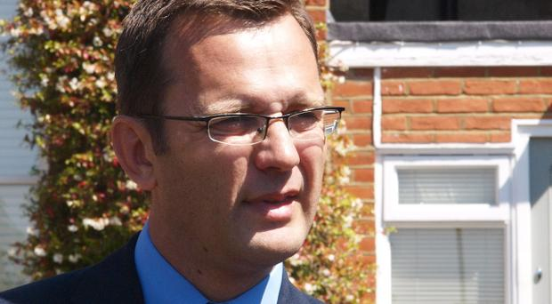 David Cameron's former spin doctor Andy Coulson, makes a statement outside his London home after the decision to prosecute him over alleged phone hacking was announced