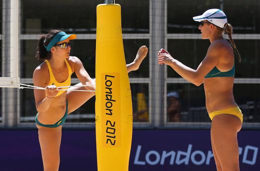 LONDON, ENGLAND - JULY 23: Becchara Palmer and Louise Bawden of Australia warm up during a Beach Volleyball training session ahead of the London Olympic Games at Horse Guards Parade on July 23, 2012 in London, England. (Photo by Ryan Pierse/Getty Images)