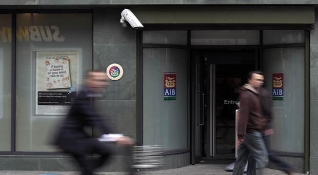 Allied Irish Bank will review the sale of interest rate swaps to small businesses